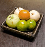 Fruit in basket. On wooden table Royalty Free Stock Images