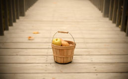 Fruit Basket. On a walkway Royalty Free Stock Photo