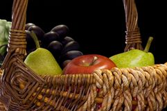 Fruit Basket. Side view of various fruits in basket Stock Image