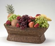 Fruit basket. Basket full of fruit Stock Images