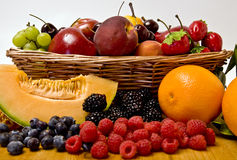 Fruit basket. A delicious selection of fruit overflowing from a basket Royalty Free Stock Photography