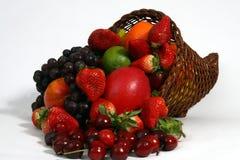 Fruit basket. Basket full of fruit on white Royalty Free Stock Photo