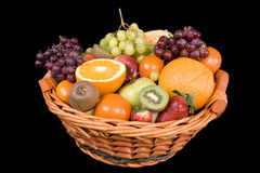 Fruit basket. With many fruits before a black background Royalty Free Stock Photos