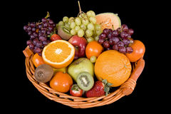 Fruit basket. With many fruits before a black background Royalty Free Stock Image