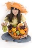 Fruit basket. Teenager with fruit basket before white background Stock Photography
