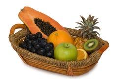 Fruit basket. Fresh fruits isolated on white Stock Image