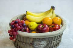 Fruit basket. With apples, bananas, oranges and lemon Stock Photo