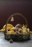 Fruit basket with bananas and candy Stock Images