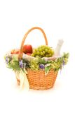 Fruit basket with a bottle of champagne. On white Royalty Free Stock Photography