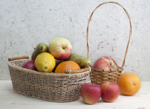 Fruit in a basket. Different fruits in the basket and  on the table Royalty Free Stock Photo
