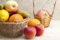Fruit in a basket. Different fruits in the basket and  on the table Stock Photo