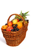 Fruit basket. Basket with different fruits on the white background stock image
