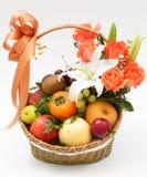Fruit basket with flower. On white background stock image