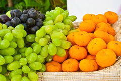 Fruit basket of grave and orange Stock Photography
