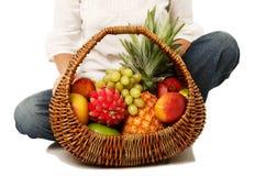 Fruit basket in hands of women. Stock Photo