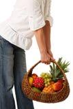 Fruit basket in hands of women. Royalty Free Stock Photo