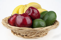 Fruit basket. Healthy and delicious apples, avocados and bananas, in the basket Stock Photography