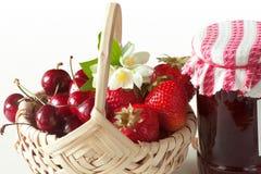 Fruit basket and jar of jam. Seasonal goodies with fresh fruits Stock Images