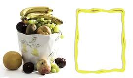 Fruit Basket with Orange, Apple, Plumb, Kiwi, Grapes, and Peaches. Fun vegan and vegetarian healthy food concept stock image