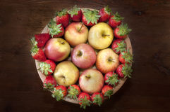 Fruit basket. A photo of a fruit basket on an old table with strawberries and appels Royalty Free Stock Photos