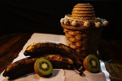 Fruit basket on a table royalty free stock photography