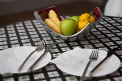 Fruit basket on the table. In the hotel Royalty Free Stock Image