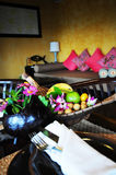Fruit basket on table. Fruit basket and table setting in a comfortable hotel room Stock Photo