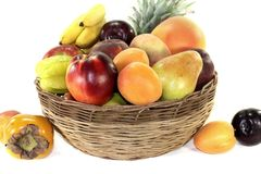 Fruit basket with various colorful fruits stock image