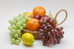 Fruit Basket. View of a basket of fruit on a off white background Stock Photo