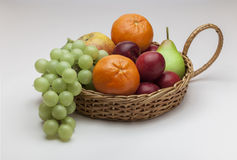 Fruit Basket. View of a basket of fruit on a off white background Stock Photos