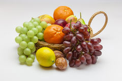 Fruit Basket. View of a basket of fruit on a off white background Stock Photography