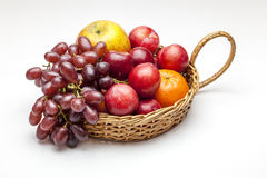 Fruit Basket. View of a basket of fruit on a white background Royalty Free Stock Photo