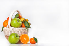 Fruit basket. Fruit in a basket on a white background Stock Photos