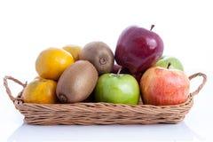 Fruit in basket on white background Stock Photos