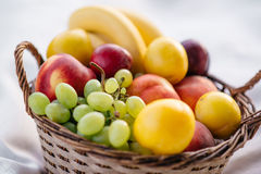 Fruit basket on a white background Stock Images