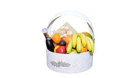 Fruit Basket. White fruit basket with fruits and cognac Royalty Free Stock Images
