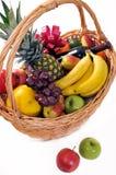 Fruit basket  with  wine. Fresh fruit basket with a bottle of wine isolated on white background Stock Image