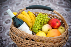 Fruit basket and wine Stock Photography