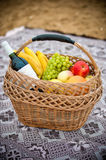 Fruit basket and wine Royalty Free Stock Images