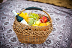 Fruit basket and wine Royalty Free Stock Photography