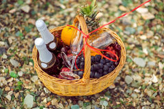 Fruit basket and wine stock image