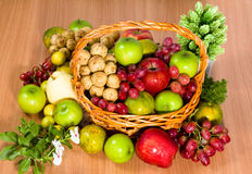 Fruit basket. On a wooden table stock photos