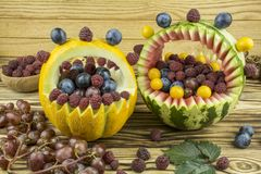 Fruit bbaskets are on a wooden table. Royalty Free Stock Image