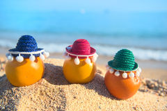 Fruit at the beach. Healthy citrus fruit with sombrero at the beach Royalty Free Stock Photos