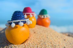 Fruit at the beach. Healthy citrus fruit with sombrero at the beach Stock Photography