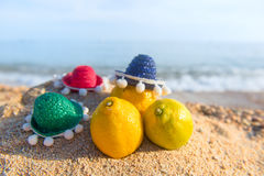 Fruit at the beach. Healthy citrus fruit with sombrero at the beach Royalty Free Stock Images