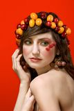 Fruit beauty woman portrait - vegetarian ideal. Portrait of young beautiful woman decorated by fruits and berries - diadem of sweet cherries and Miniature Orange Stock Photography