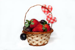 Fruit and berries in a basket Stock Images