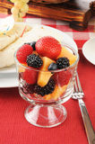 Fruit and berries with breakfast burritos Royalty Free Stock Photo