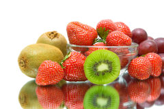 Fruit and berries close up on a white background. Fruits and berries. kiwi, strawberry and grape close-up on a white background. horizontal photo royalty free stock image